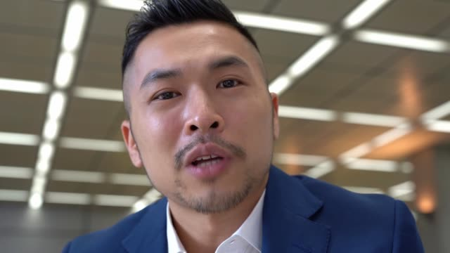 Asian businessman having video conference with customer Chinese businessman having video conference with customer handsome people stock videos & royalty-free footage