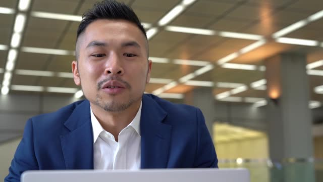 Asian businessman having video conference with customer Chinese businessman having video conference with customer businesswear stock videos & royalty-free footage