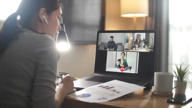 Asian Businesswoman having Video call meeting with team at home