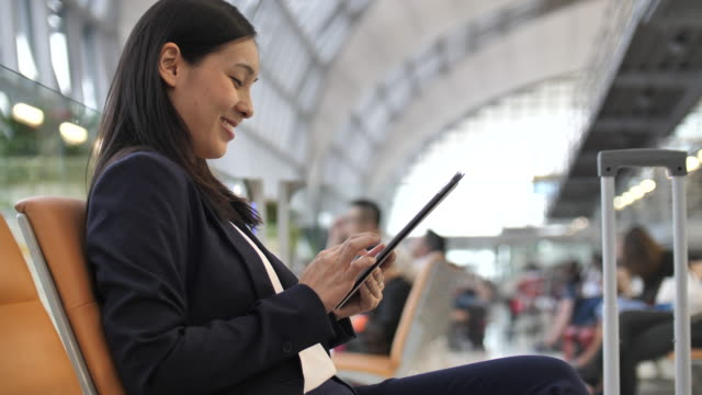 Asian businesswoman using Digital tablet in airport