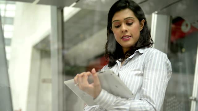Asian Businesswoman using digital tablet video