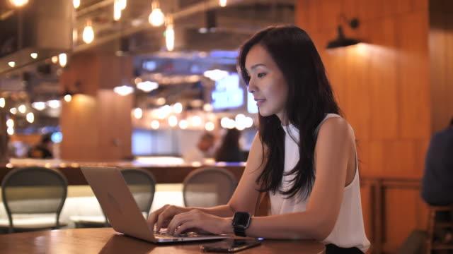 Asian Businesswoman using laptop