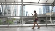 istock Asian Businesswoman walking city 1274084575