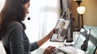 istock Asian Businesswoman working Video Call with her boss on Digital tablet at home 1215338427