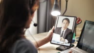 istock Asian Businesswoman working Video Call with her boss on Digital tablet at home 1215340996