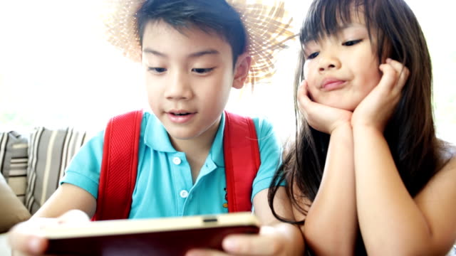 Asian child playing smart phone together video