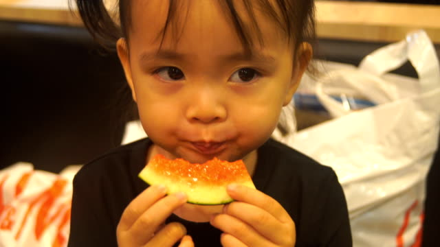 Asian children eating watermelon video