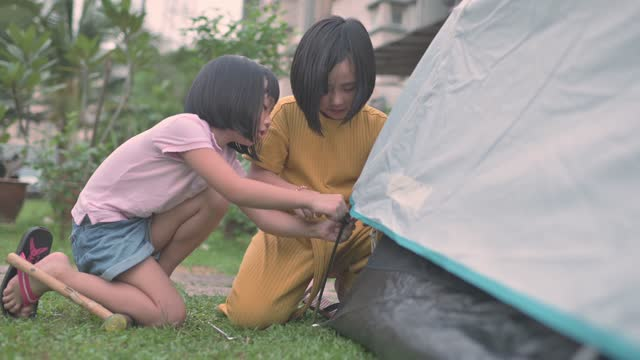 asian chinese family 2 sisters setting up camping at backyard of their house staycation weekend activities