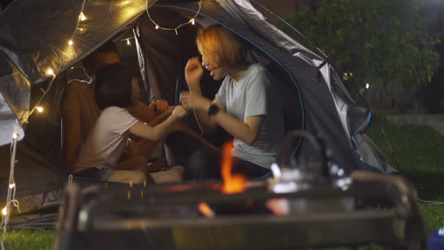 asian chinese family camping at backyard of their house staycation weekend activities