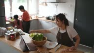 istock asian chinese mother cooking preparing food at kitchen counter and learning it from internet using digital tablet 1271311745
