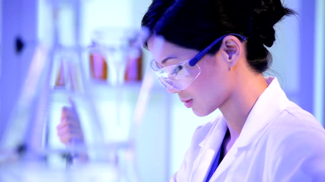 Asian Chinese Researcher Working in Hospital Laboratory video