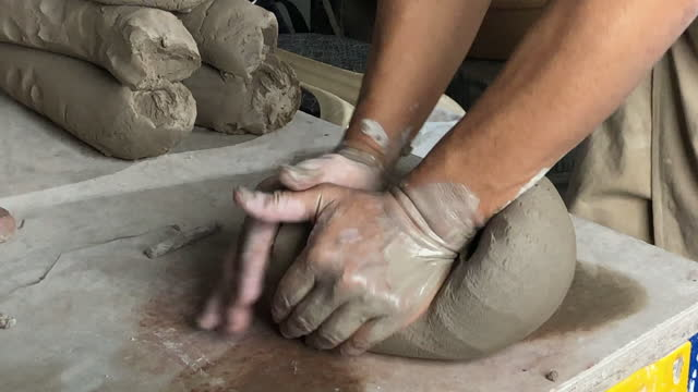 Asian chinese senior man clay artist getting ready with clay in his craft studio