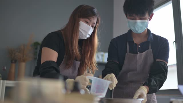 asian chinese teenage boy learning the soap making process from female artist