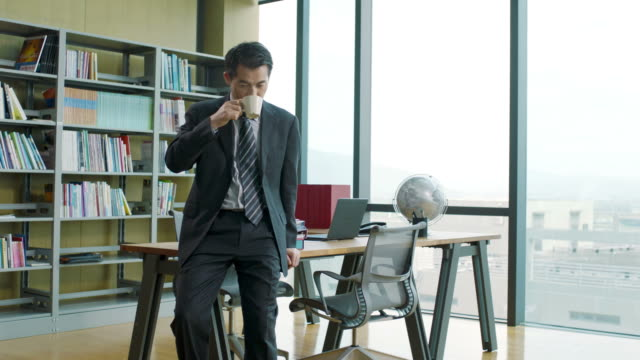 asian corporate executive thinking in office video