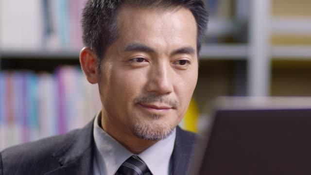 オフィスで働くアジアの企業経営者 - ビジネスマン点の映像素材/bロール