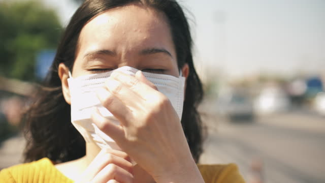 asian coughing sick girl wearing air pollution mask - mask стоковые видео и кадры b-roll