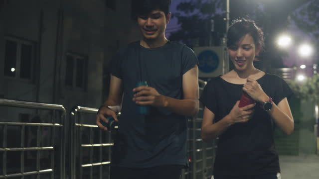 Asian couple after exercising and jogging in the city.