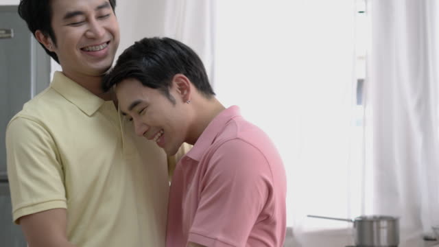 Asian couple gay celebrating at home. Gay boy drinking beverage for happy emotion love anniversary together. Concept of lifestyle, family, gay and bisexual. Asian couple gay celebrating at home. Gay boy drinking beverage for happy emotion love anniversary together. Concept of lifestyle, family, gay and bisexual. bisexuality stock videos & royalty-free footage