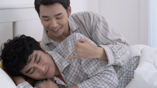 Asian couple gay happy emotion morning in the bedroom at home. Gay boy lying on bed and hug love anniversary together. Concept of lifestyle, family, gay and bisexual. Asian couple gay happy emotion morning in the bedroom at home. Gay boy lying on bed and hug love anniversary together. Concept of lifestyle, family, gay and bisexual. bisexuality stock videos & royalty-free footage