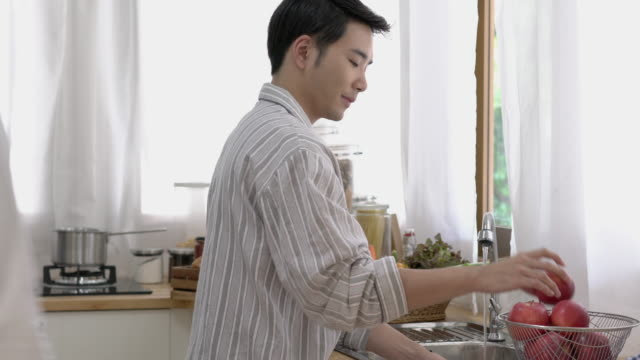Asian couple gay housekeeping in morning at home. Gay boy happy emotion and hug love anniversary together. Concept of lifestyle, family, gay and bisexual. Asian couple gay housekeeping in morning at home. Gay boy happy emotion and hug love anniversary together. Concept of lifestyle, family, gay and bisexual. bisexuality stock videos & royalty-free footage