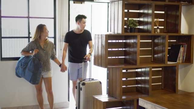 Asian couple renting a house for vacation
