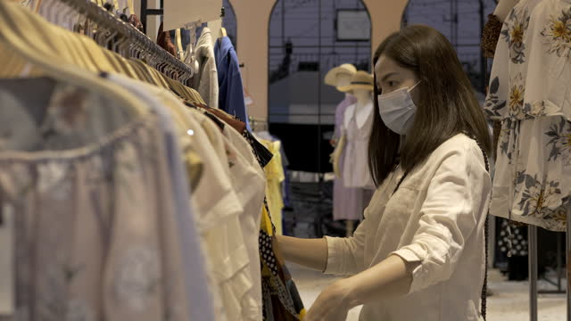 Asian couple with face mask shopping some cloth during covid-19 covid corona virus situation