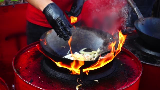 Asian cuisine. Cooking in a wok pan. Slow motion. video