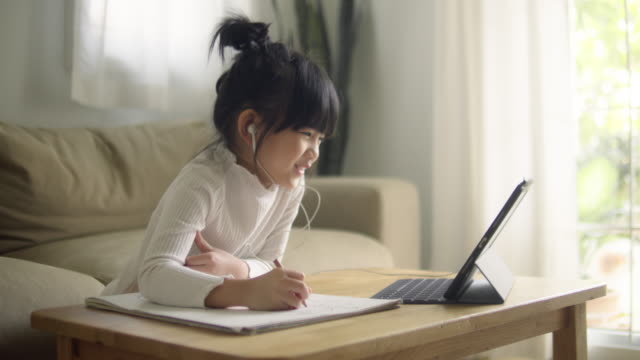 asian daughter attending to online class from home. - social distancing stock videos & royalty-free footage