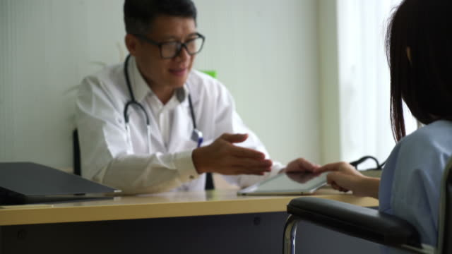 Asian doctor and patient are discussing something Asian doctor and patient are discussing something employee engagement stock videos & royalty-free footage