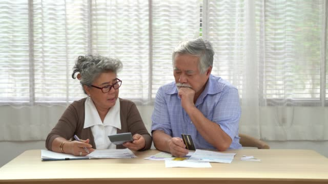 Asian elderly couples are worried when they calculate the monthly expenses they have to pay, Financial problems at retirement. Asian elderly couples are worried when they calculate the monthly expenses they have to pay, Financial problems at retirement. financial planning stock videos & royalty-free footage