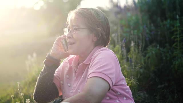 asian elderly women in glasses works at home - 60 69 anni video stock e b–roll