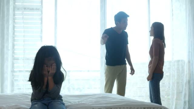 asian family brawling and girl crying , conflict concepts - walczyć filmów i materiałów b-roll