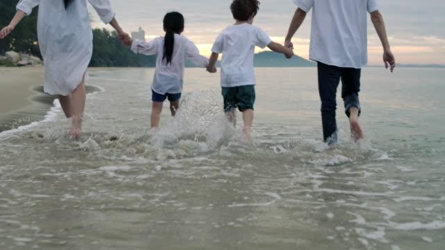 Asian family on a tropical beach vacation.