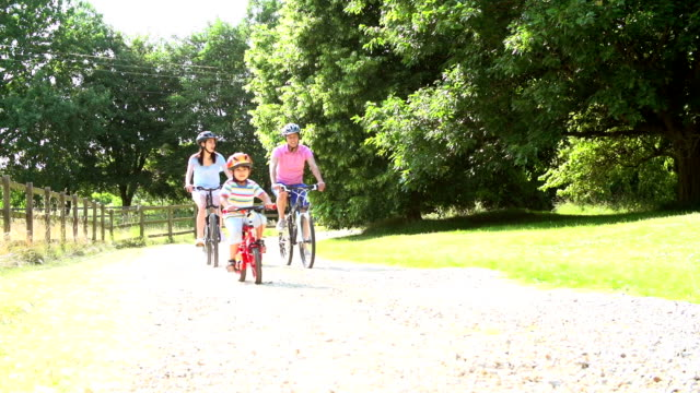 Asian Family On Cycle Ride In Countryside video