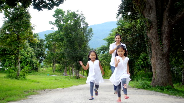 Asian family running in the park together. Concept the happiness family in freedom day. video