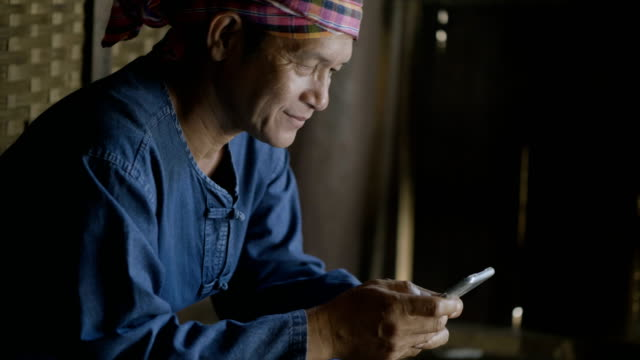 Asian Farmer With Agriculture App On Smart Phone