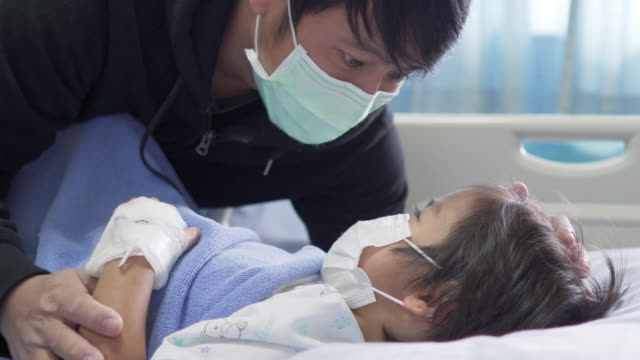 Asian father visiting his sick Son in hospital 4K MS Asian father visiting his sick Son in hospital one parent stock videos & royalty-free footage