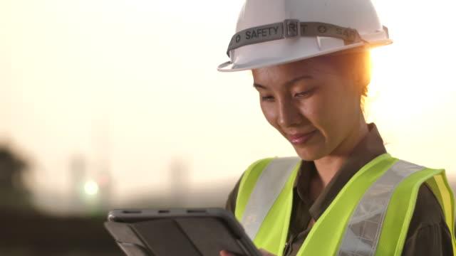 Asian Female Engineer working on Digital tablet