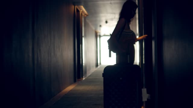 Asian Female Guest Walking Into Hotel Room