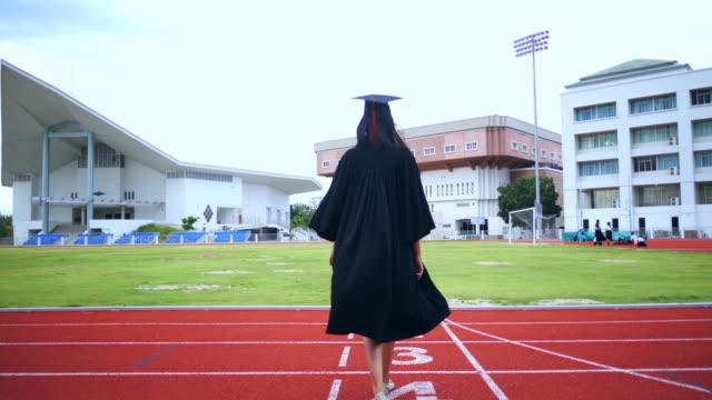 asian female students graduated of the university - celebrazione della laurea video stock e b–roll