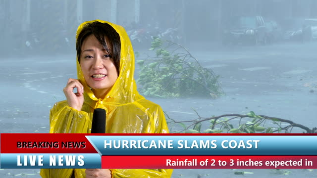 Asian female TV weather reporter reporting on hurricane video