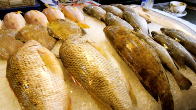 Asian fresh fishes, seafood selling in Hua Hin market, Thailand