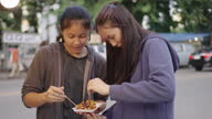 istock Asian friends tasting Mix meatballs and dumplings. Thai street food. 1287909228
