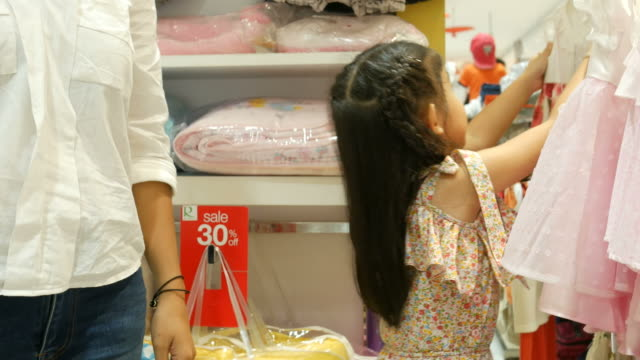 Asian girl and mother having fun shopping together Asian girl and mother having fun shopping together department store stock videos & royalty-free footage