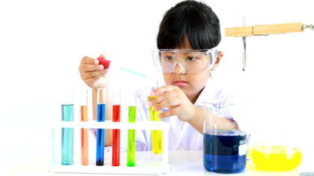 asian girl doing an experiment in laboratory with lab tubes video