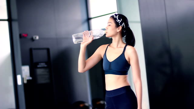 asian girl drinking water after workout video