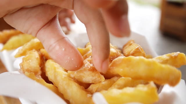 Asian Girl eating French fries, Slow motion Asian Girl eating French fries, Slow motion french fries stock videos & royalty-free footage