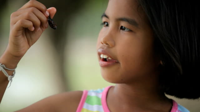 Asian girl eating insects video