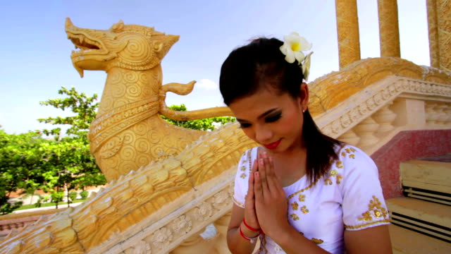 Asian Girl Greets in temple traditional way with both hands video