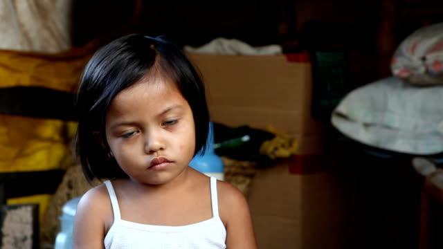 Asian girl living in poverty Adorable young Asian girl living in poverty. Impoverished in the Philippines, squatter area. Canon 5DmkII. one girl only stock videos & royalty-free footage